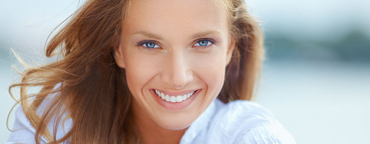 Smiling woman with bright blue eyes